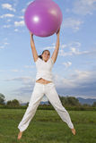 Cute smilling brunettewith the the pink ball Royalty Free Stock Photos