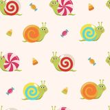 Seamless pattern with cartoon candy snails and sweets. Cute snails with colorful candy shells, a childish background. A childhood concept seamless pattern Royalty Free Stock Photos