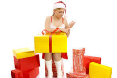 Cute Snow Maiden with a number of gift boxes. Royalty Free Stock Images