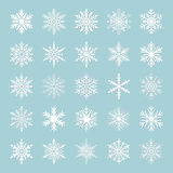 Cute snowflake collection isolated on blue background. Flat snow icons, snow flakes silhouette. Nice snowflakes for christmas bann Royalty Free Stock Photography