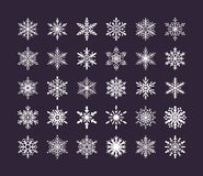 Cute snowflakes collection isolated on dark background. Flat snow icons, snow flakes silhouette. Nice element for vector illustration
