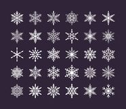 Cute snowflakes collection isolated on dark background. Flat snow icons, snow flakes silhouette. Nice element for stock illustration