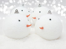 Cute Snowman baubles in snow Royalty Free Stock Photo