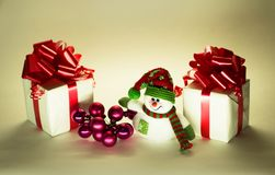 Cute snowman with Christmas balls Stock Images