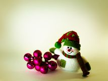 Cute snowman with Christmas balls Stock Photo