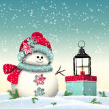 Cute snowman with colorful present and vintage Royalty Free Stock Photos