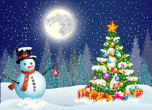 Cute snowman decorating a Christmas tree Stock Photography