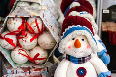 Cute snowman doll. And christmas tree balls Stock Images