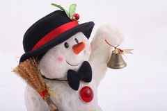 Cute Snowman doll with hat. Cute snowman doll captured in close up over white background Royalty Free Stock Images