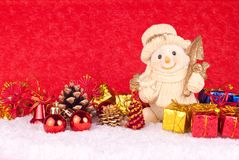 Cute snowman figure on red background Stock Photos