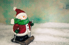 Cute snowman figure skiing Royalty Free Stock Photography