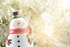 Cute snowman on gold streamer or tinsel background Stock Photography