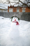 Cute snowman in his red outfit and hat Stock Image