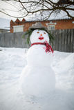Cute snowman in his red outfit and hat Stock Photography