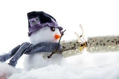 Cute snowman pulling a cracker Stock Photo