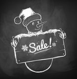 Cute Snowman with sale sign Royalty Free Stock Images