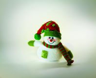 Cute snowman with scarf on white background Stock Images