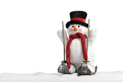 Cute snowman on skis Royalty Free Stock Photography