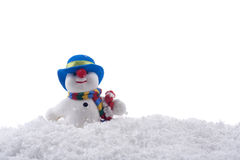 Cute snowman with snow Royalty Free Stock Photography