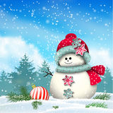 Cute snowman in snowy winter landscape Royalty Free Stock Images