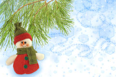 Cute snowman under a pine tree Stock Photo