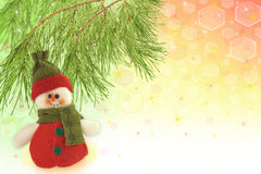 Cute snowman under a pine tree Stock Photos