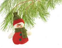 Cute snowman under a pine tree isolated on white Stock Photos