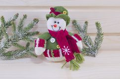 Cute snowman wearing a hat on a wooden surface Stock Photos