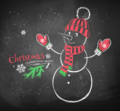 Cute snowman wearing knittted hat. Royalty Free Stock Photo