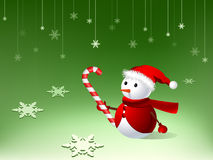 Cute snowman with xmas cane Royalty Free Stock Photos