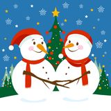 Cute Christmas snowmen. Cute snowmen with Christmas hats hug in a beautiful snowy landscape with Christmas trees at night Royalty Free Stock Image