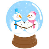 Cute snowmen inside a snow globe Royalty Free Stock Photos
