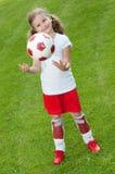 Cute soccer player Stock Photos