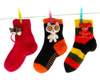 Cute Socks Hanging on a Clothes Line. Cute colorful socks hanging on a clothes line isolated on white background Royalty Free Stock Photography