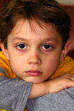 Cute Somber Sober Young Dark Haired 6yr Old Boy. Cute sad somber looking young 6yr old boy with dark hair & dark eyes Stock Images