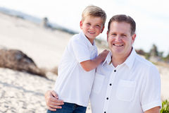Cute Son with His Handsome Dad at the Beach. Cute Son with His Handsome Dad Portrait at The Beach Royalty Free Stock Photos