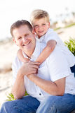 Cute Son with His Handsome Dad Portrait. At the Beach Stock Images