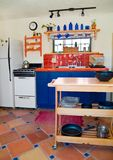 Cute southwestern kitchen. Cute southwest style kitchen with traditional saltilla tiles on the floor Royalty Free Stock Photography