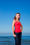 Cute sport girl at the beach Royalty Free Stock Image