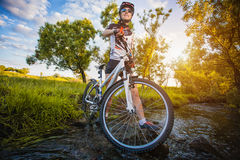 Cute sportswoman on bicycle. Active Leisure Stock Images