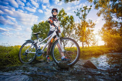 Cute sportswoman on bicycle. Active Leisure Royalty Free Stock Photos