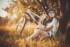 Cute sportswoman with a bicycle. Active Leisure Stock Images