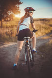 Cute sportswoman on bicycle. Active Leisure Royalty Free Stock Photo