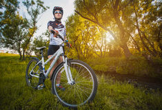 Cute sportswoman on bicycle. Active Leisure Stock Photos