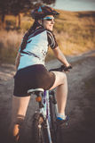 Cute sportswoman on bicycle. Active Leisure Stock Image