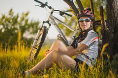 Cute sportswoman with a bicycle. Active Leisure Stock Photo