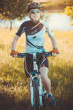 Cute sportswoman on bicycle. Active Leisure Stock Photo