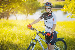 Cute sportswoman on bicycle. Active Leisure Stock Photography