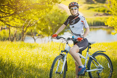 Cute sportswoman on bicycle. Active Leisure Royalty Free Stock Images