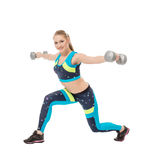 Cute sporty girl posing with dumbbells Royalty Free Stock Photo